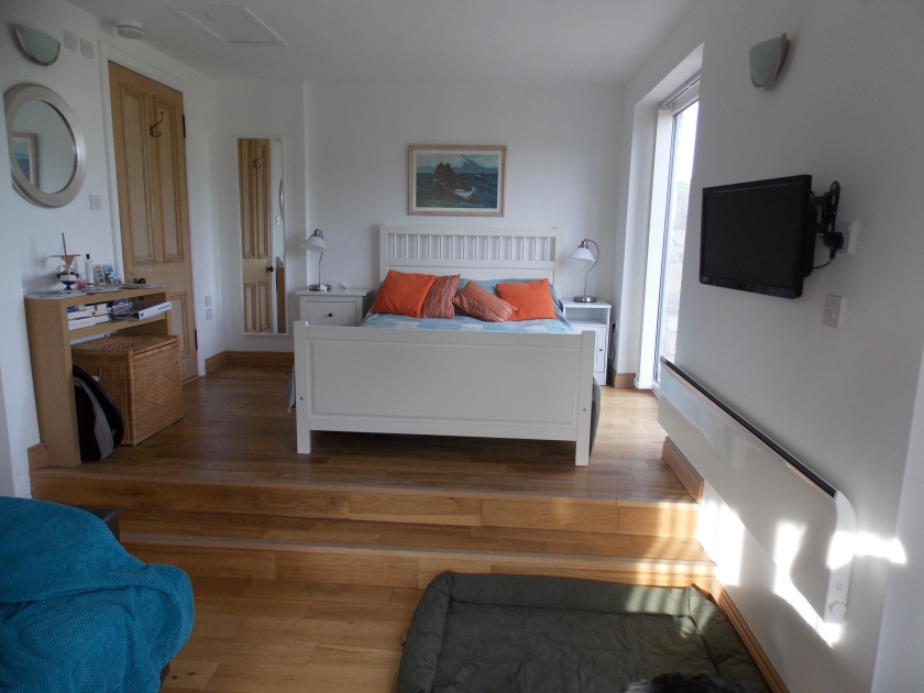 Raised bedroom area with a view out to the field at the bottom of the garden - Lovely.